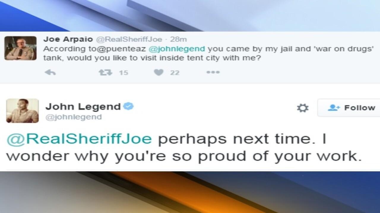 John Legend, Juanes perform outside AZ jail