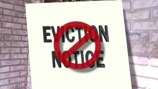 'Eviction Notice' crossed out in front of Boca Raton home