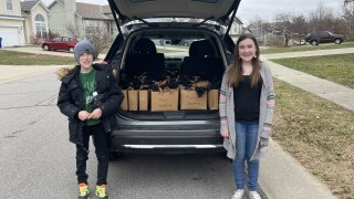 """Kai and Morgan Forshee deliver """"Bags of Blessings"""" to the homeless."""