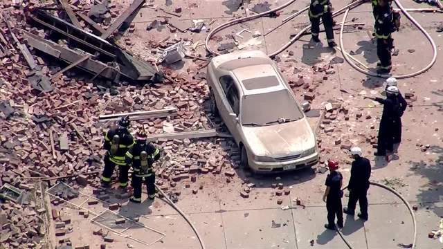 PHOTOS: Natural gas explosion levels building on Santa Fe Drive in Denver
