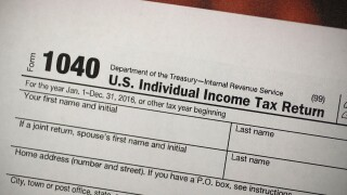 Free tax filing easier this year, but there's still a catch