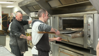 Restaurant gives out pizzas to raise funds for two local organizations