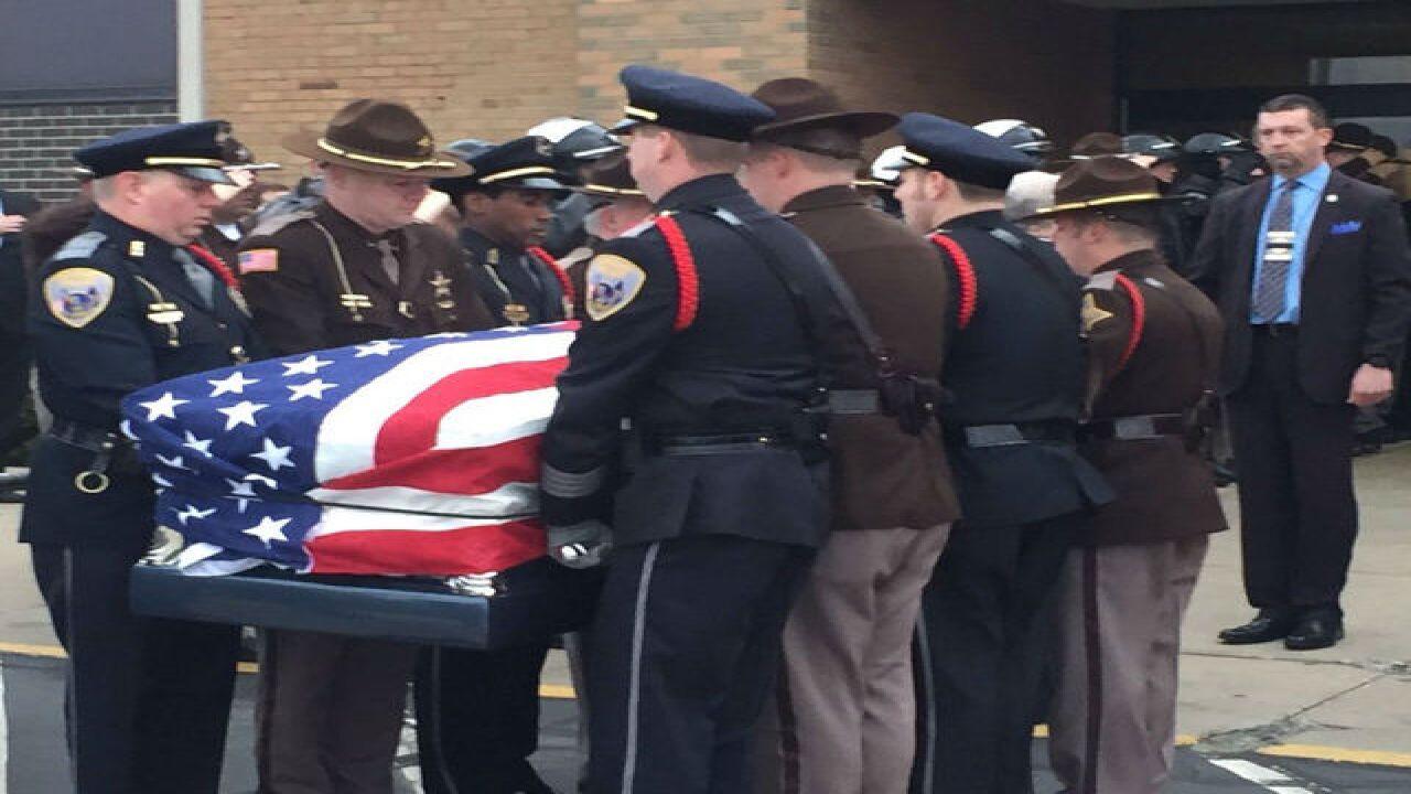 PICS: Koontz's casket arrives for visitation