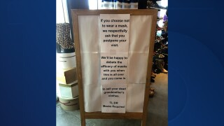 Antique shop's sign goes viral for message about mandating masks