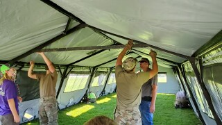 "MT National Guard and boy scouts help set up ""isolation shelters"""