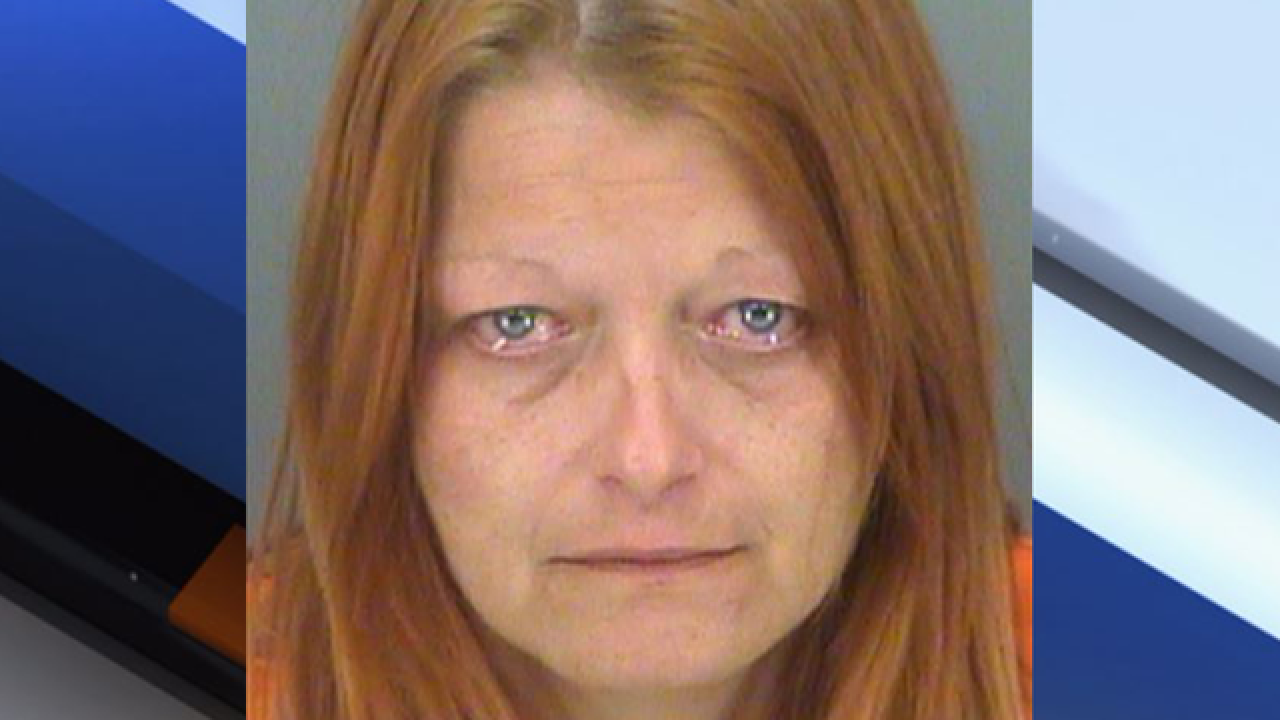 Woman accused of stealing from cancer patient