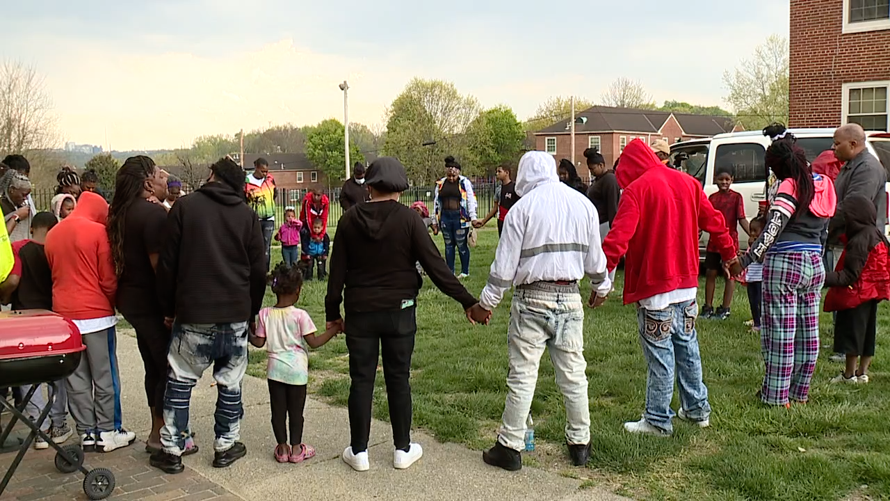 Friends, family gather to remember slain Winton Hills 13-year-old.png