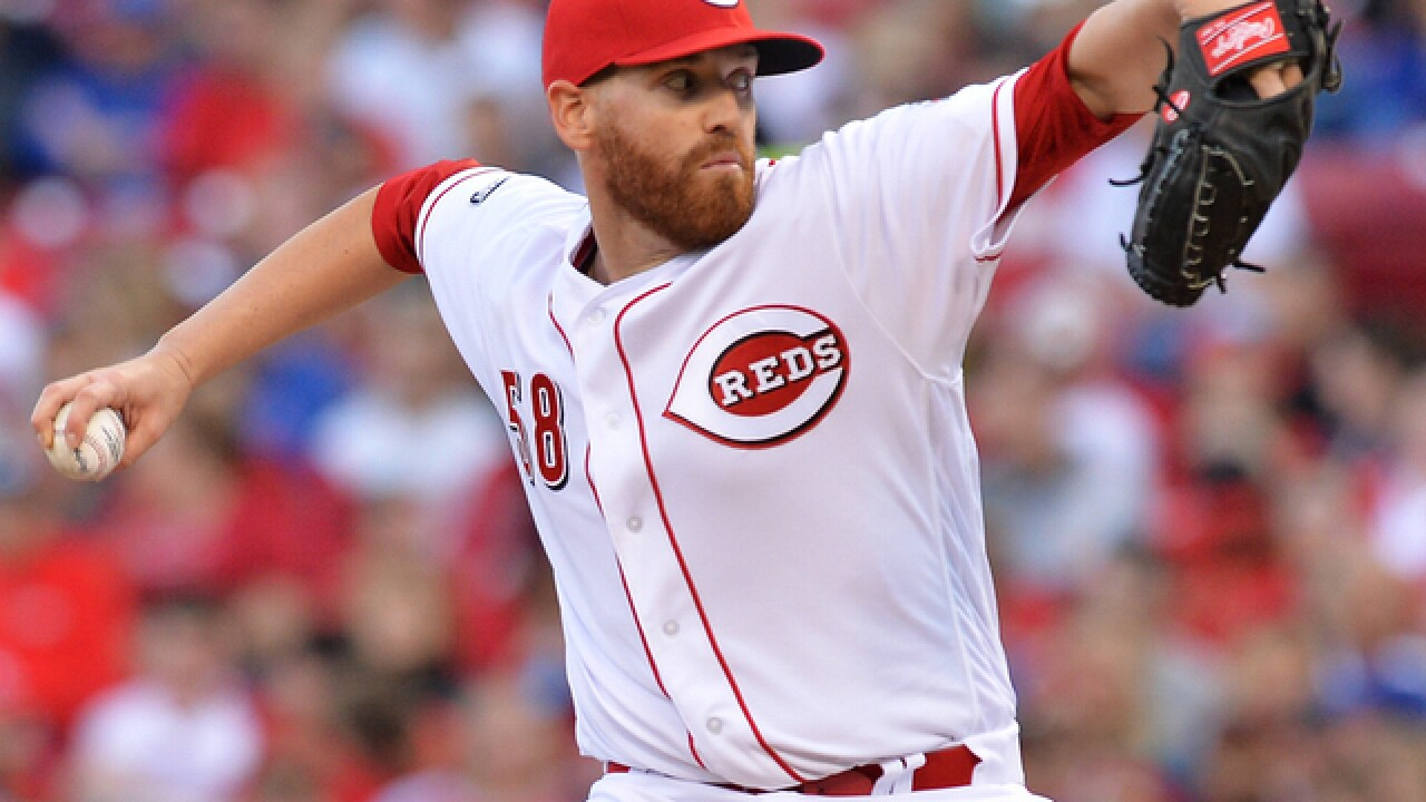 Reds hit season-high 4 homers, beat Cubs 13-5