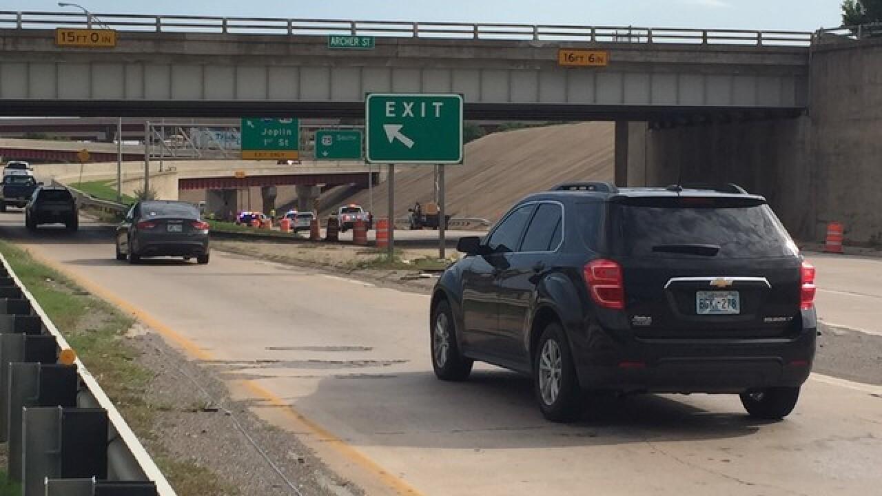 Semi truck stuck under Highway 75 bridge