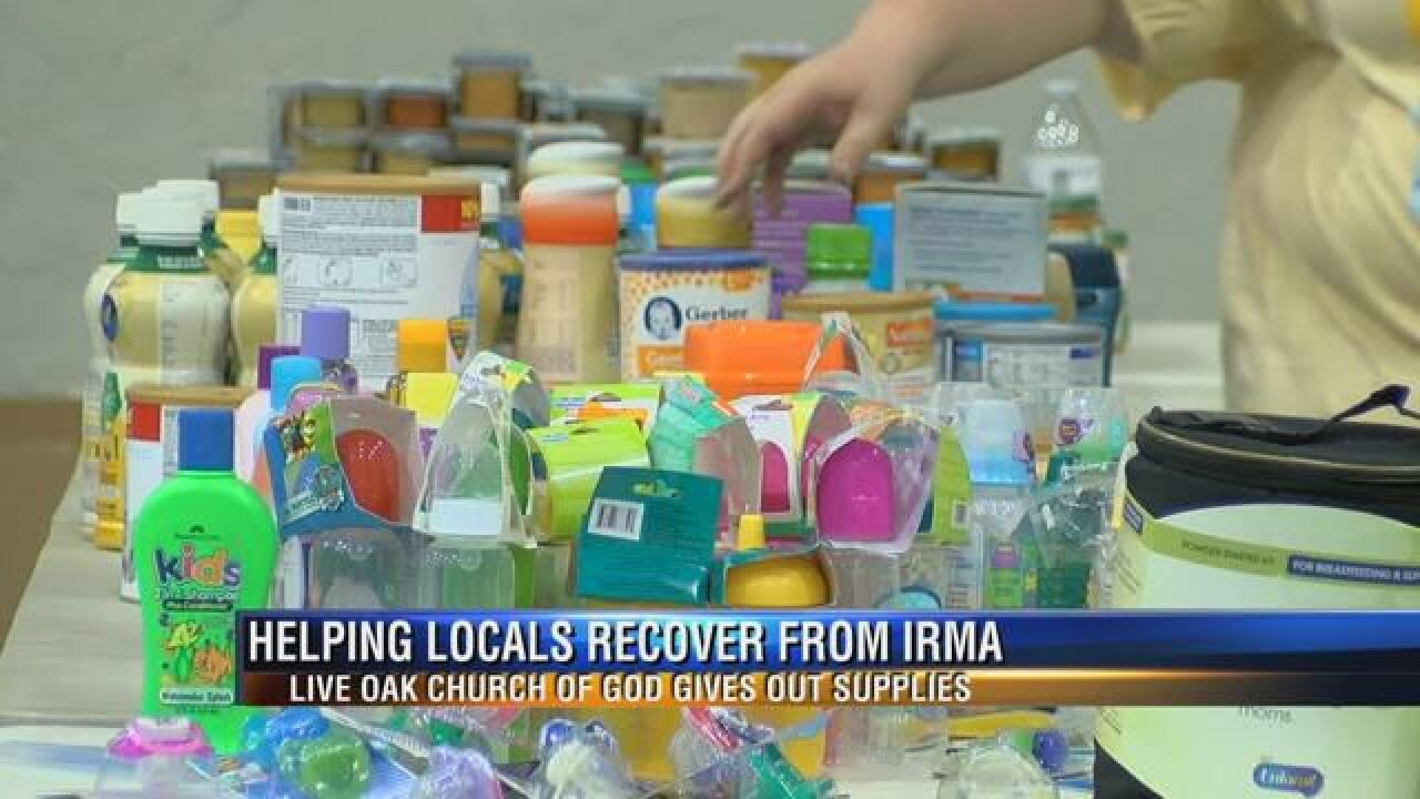 live oak church of god gives out supplies