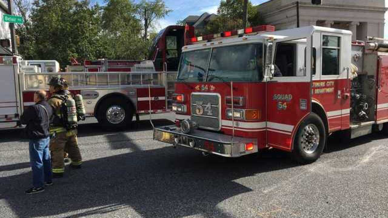 Crews work to extinguish fire on Belair Road