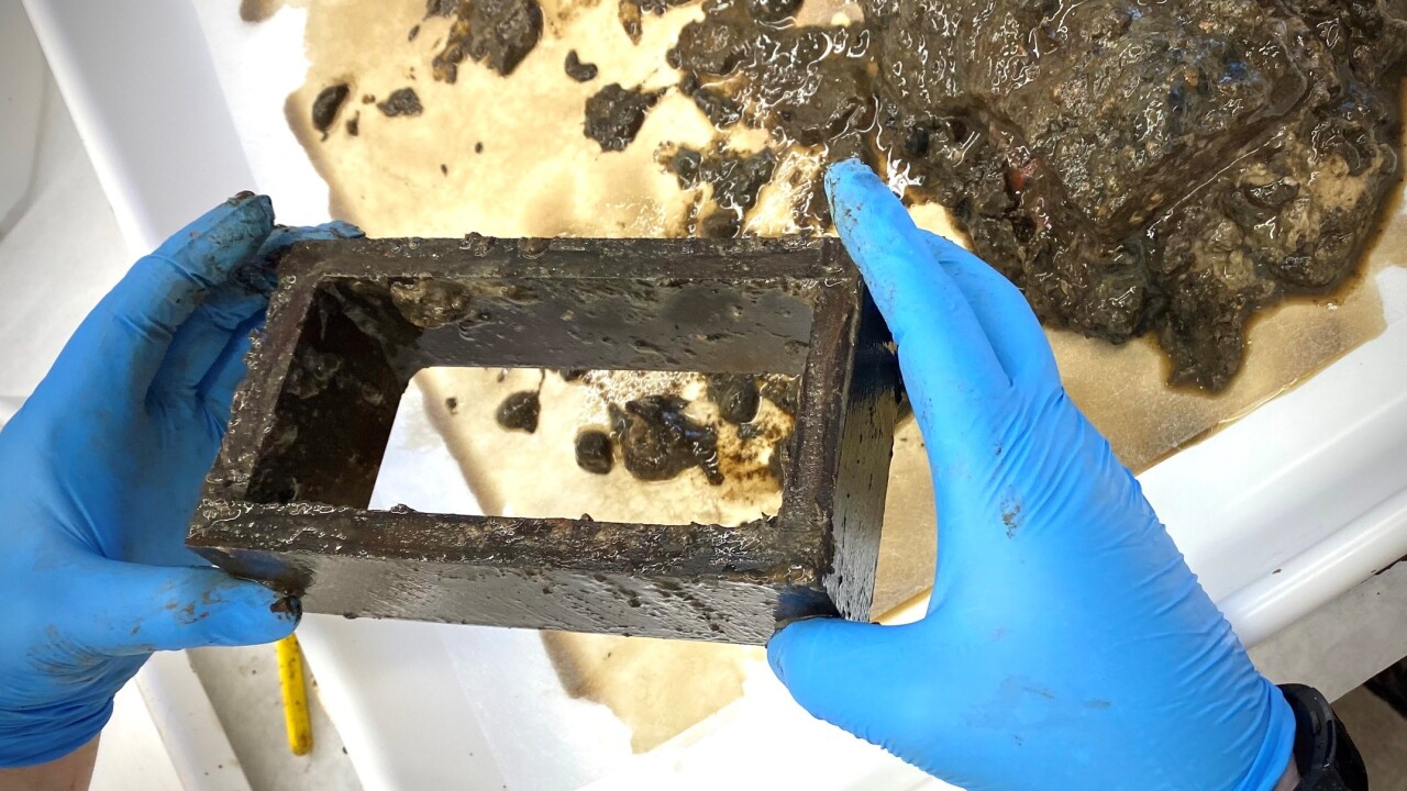 Time capsule under removed Confederate statue reveals Gen. Robert E. Lee buttons, songbook