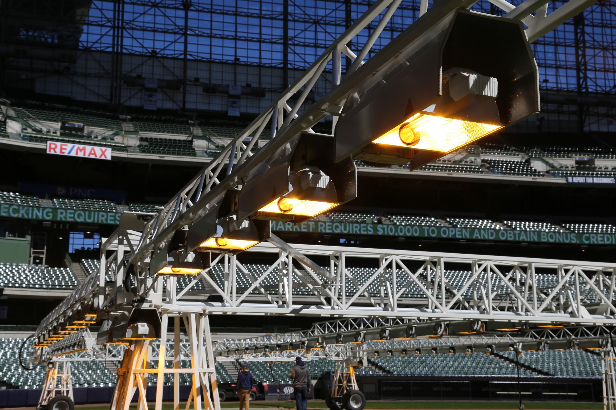Heat lamps on Miller Park infield