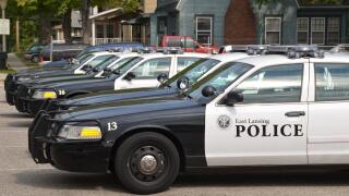 East Lansing Police Officer pinned by RV after torchrun
