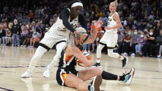 Brittney Griner dunked while scoring 29 points, Diana Taurasi had eight of her 20 points in overtime and Phoenix Mercury evened the WNBA Finals with a 91-86 win over the Chicago Sky. AP photo.