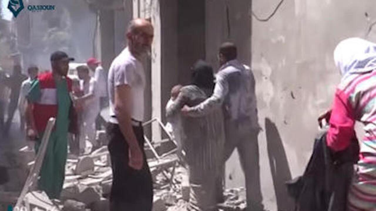 Activists say dozens killed in Syrian airstrike
