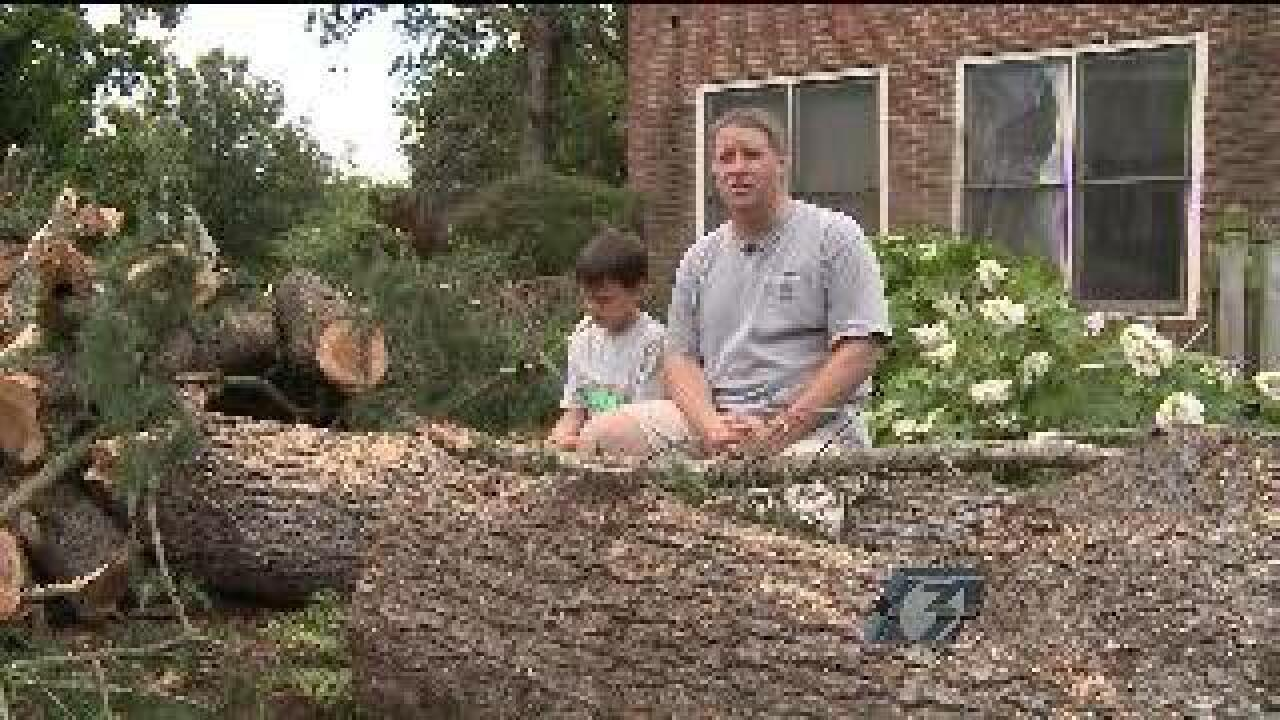 Neighbors help each other clean up in Park Place