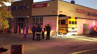 School bus crashes into side of building in Indianapolis, no injuries reported