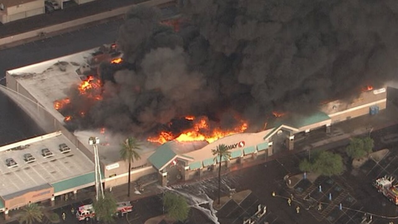 Massive fire at Phoenix supermarket causes roof collapse, no injuries reported