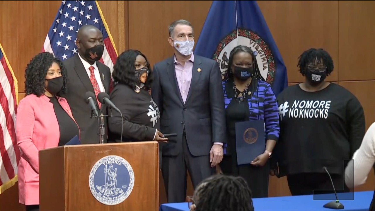 With Breonna Taylor's family in attendance, Virginia governor signs bill banning no-knock warrants