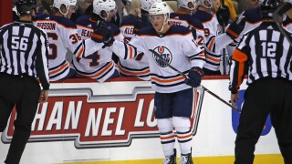 Oilers' Cave out of emergency surgery, remains in coma