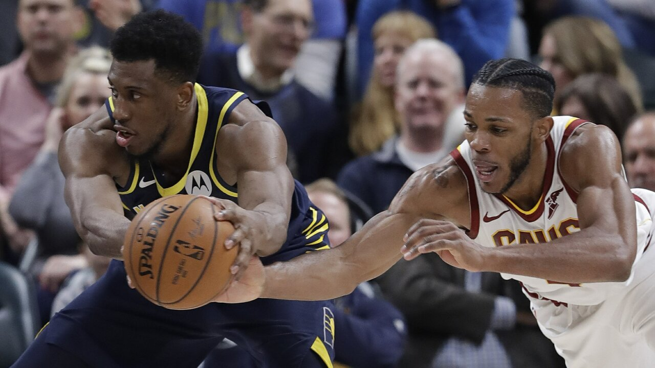 Indiana Pacers' Thaddeus Young (21) is defended by sCleveland Cavaliers' Jaron Blossomgame (4) during the second half of an NBA basketball game, Tuesday, Dec. 18, 2018, in Indianapolis. Cleveland won 92-91. (AP Photo/Darron Cummings)