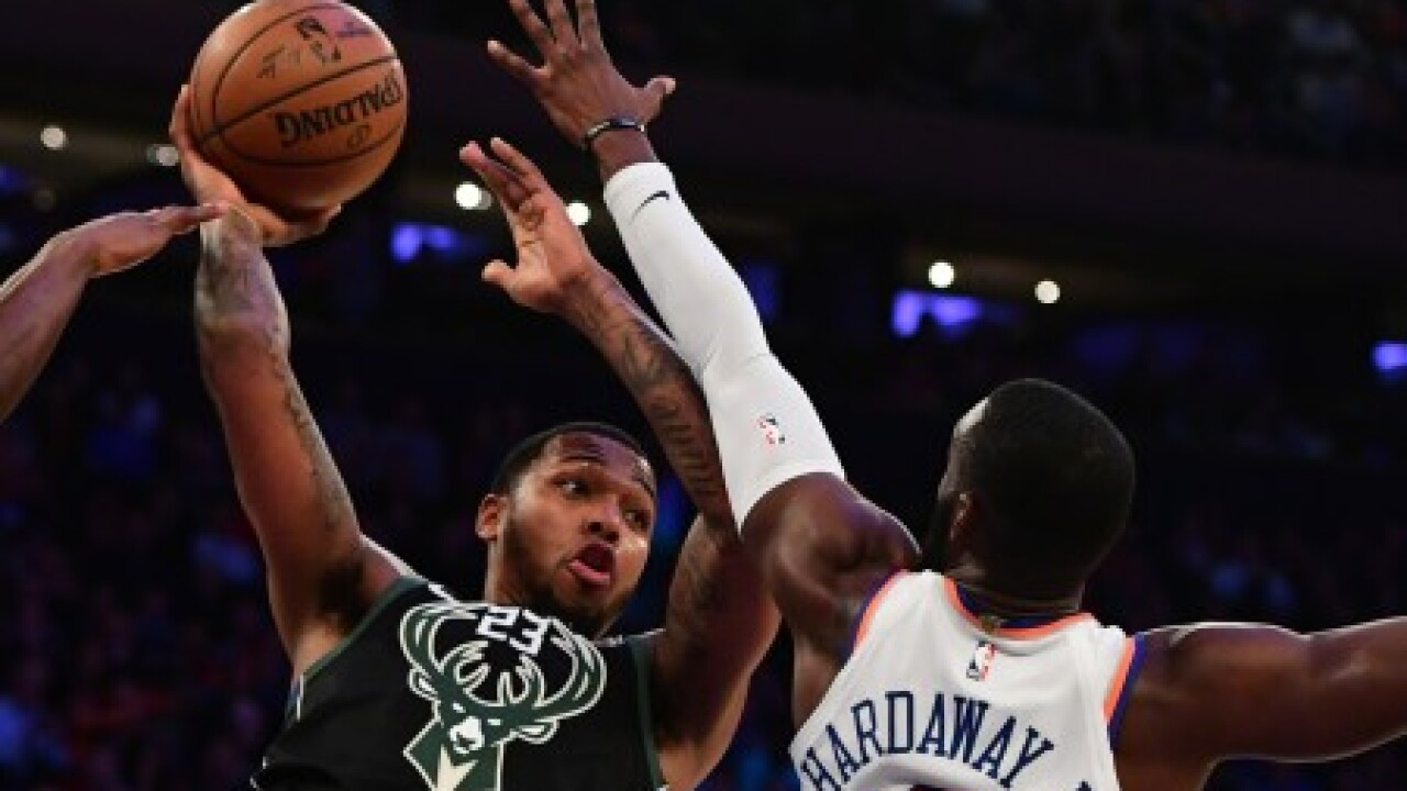 Sterling Brown looks to pass basketball