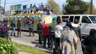 Decorated floats and revelers travel down the streets of Franklin