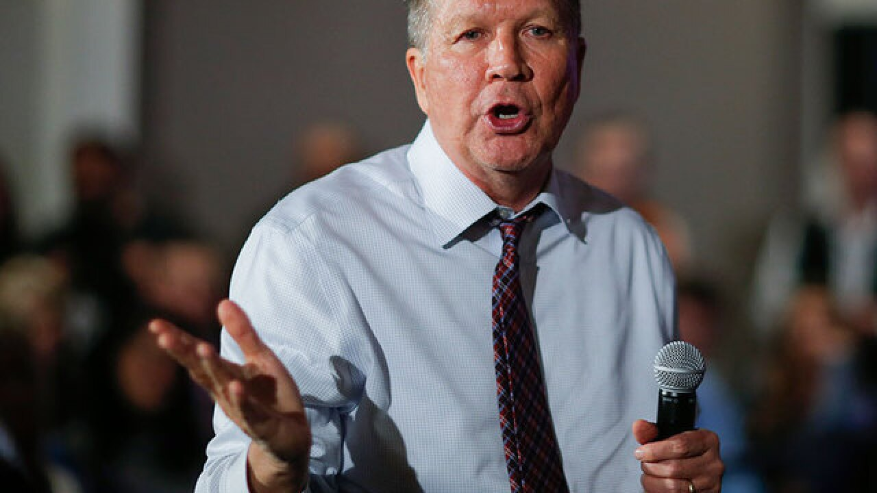 Why is Kasich sticking with his strategy?