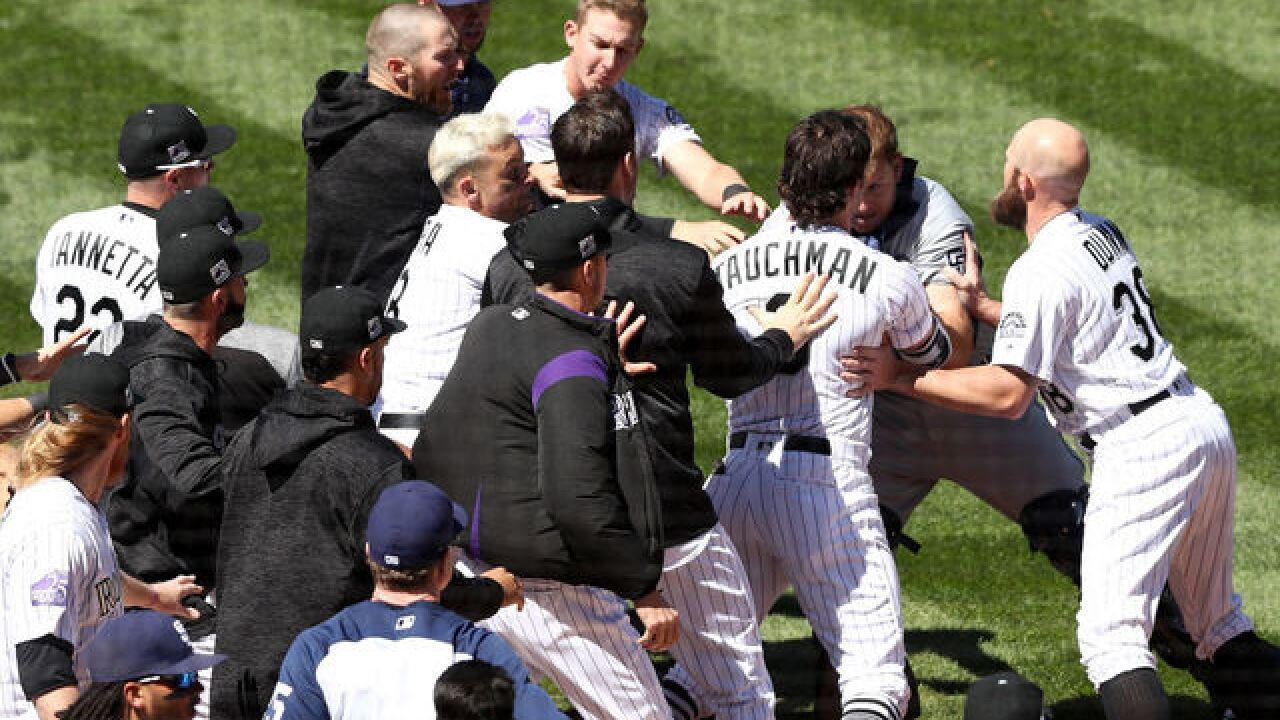 Rockies' Nolan Arenado, Gerardo Parra suspended for role in brawl