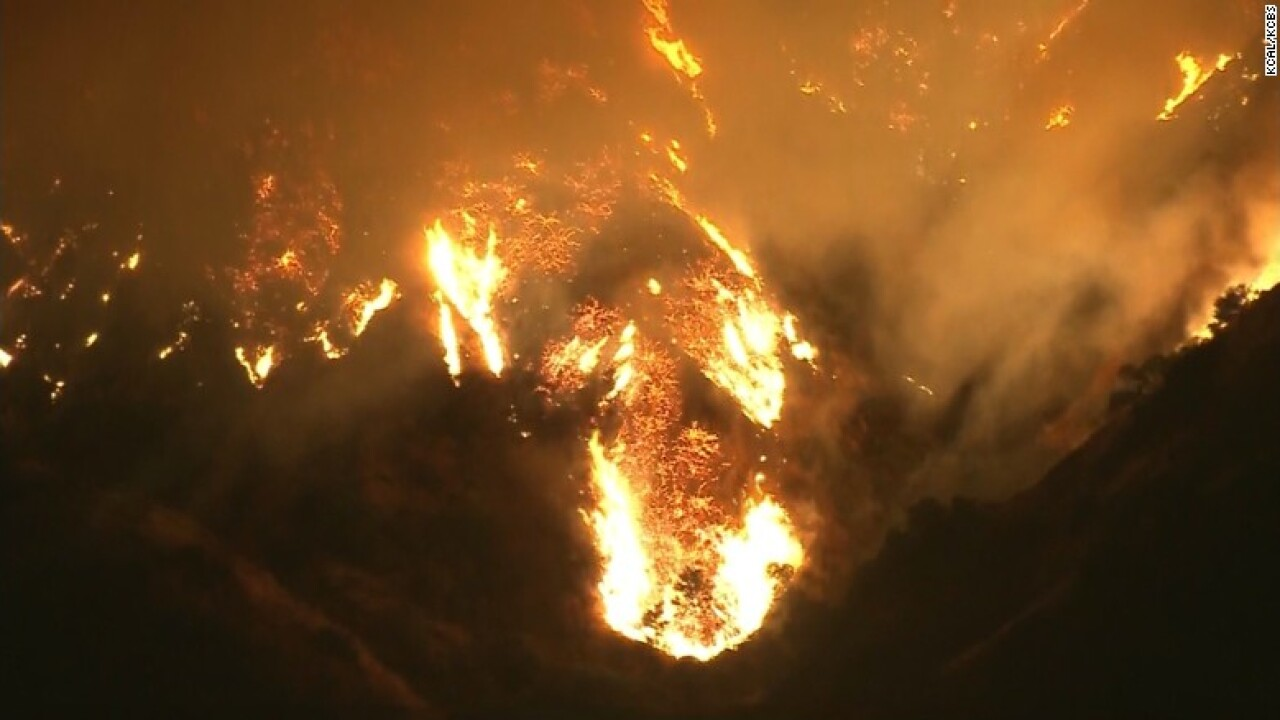 Los Angeles brush fire forces hundreds to flee homes