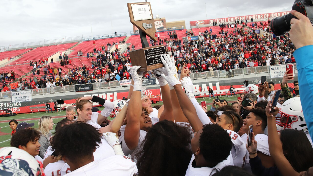 The young men of the Liberty High School football team won the state championship last year. This year, they face new challenges.