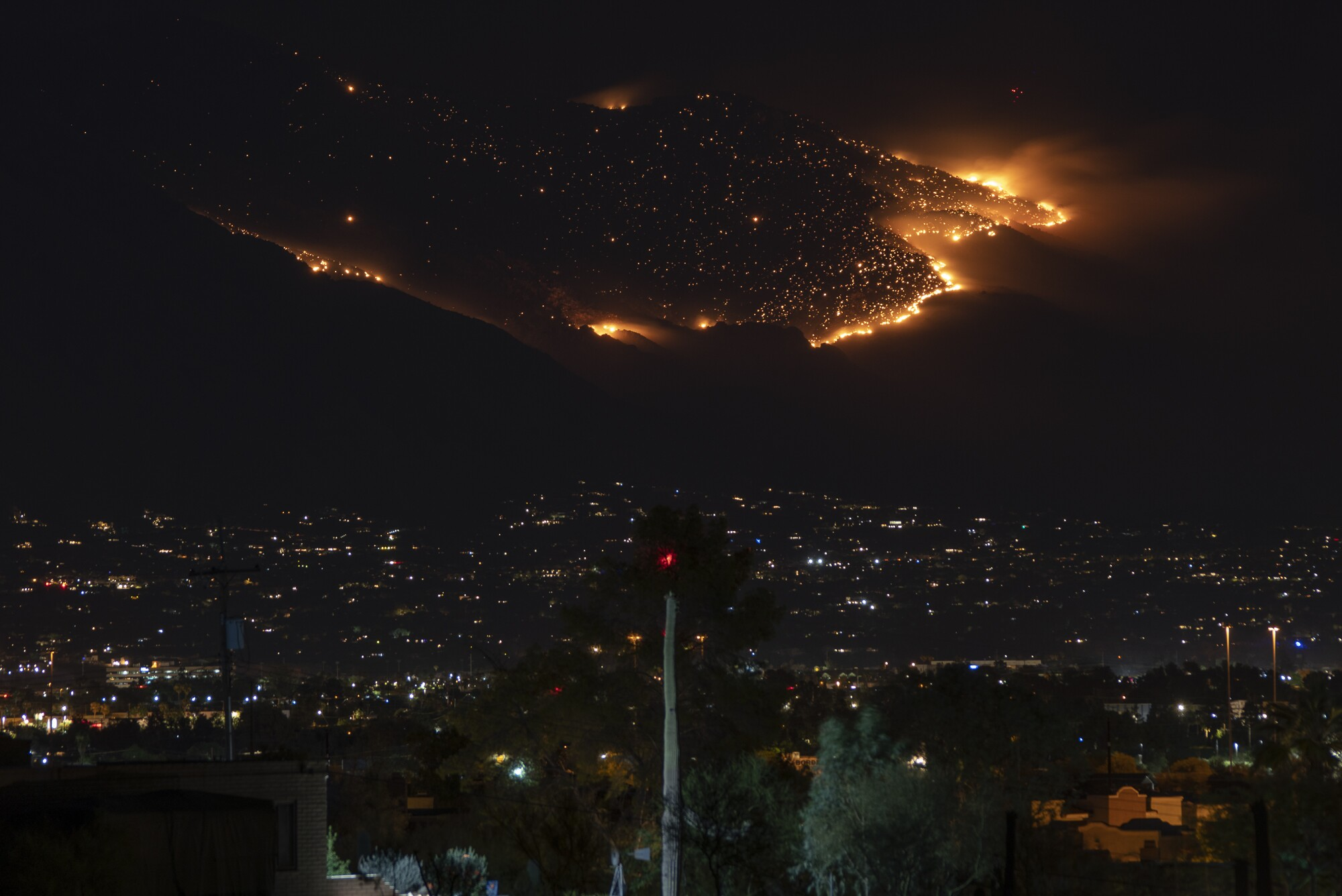 The Bighorn Fire as seen at night with the city of Tucson in the foreground