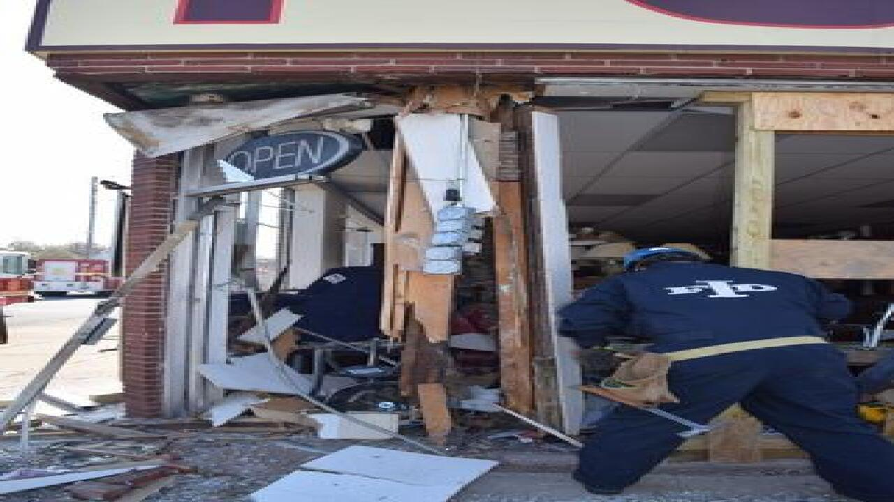PHOTOS: Van plows into furniture store