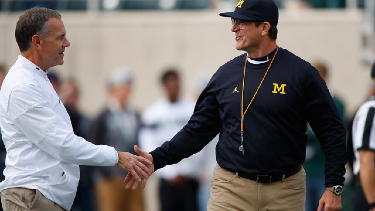 Jim Harbaugh, Mark Dantonio trade jabs on Twitter