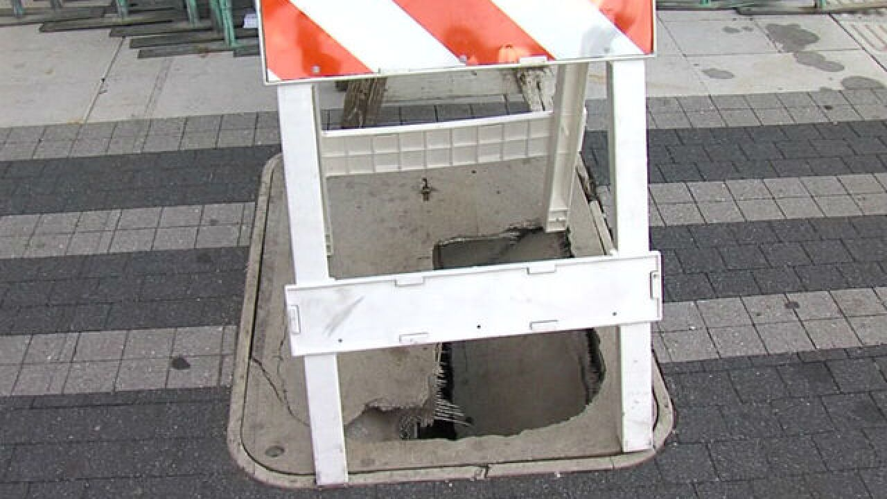 Panel cracks downtown, creates hole in sidewalk
