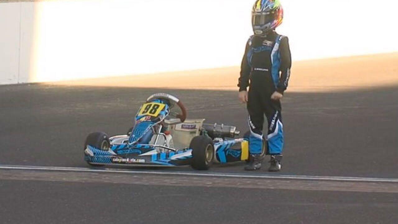 Wheldon's 9-year-old son drives at IMS