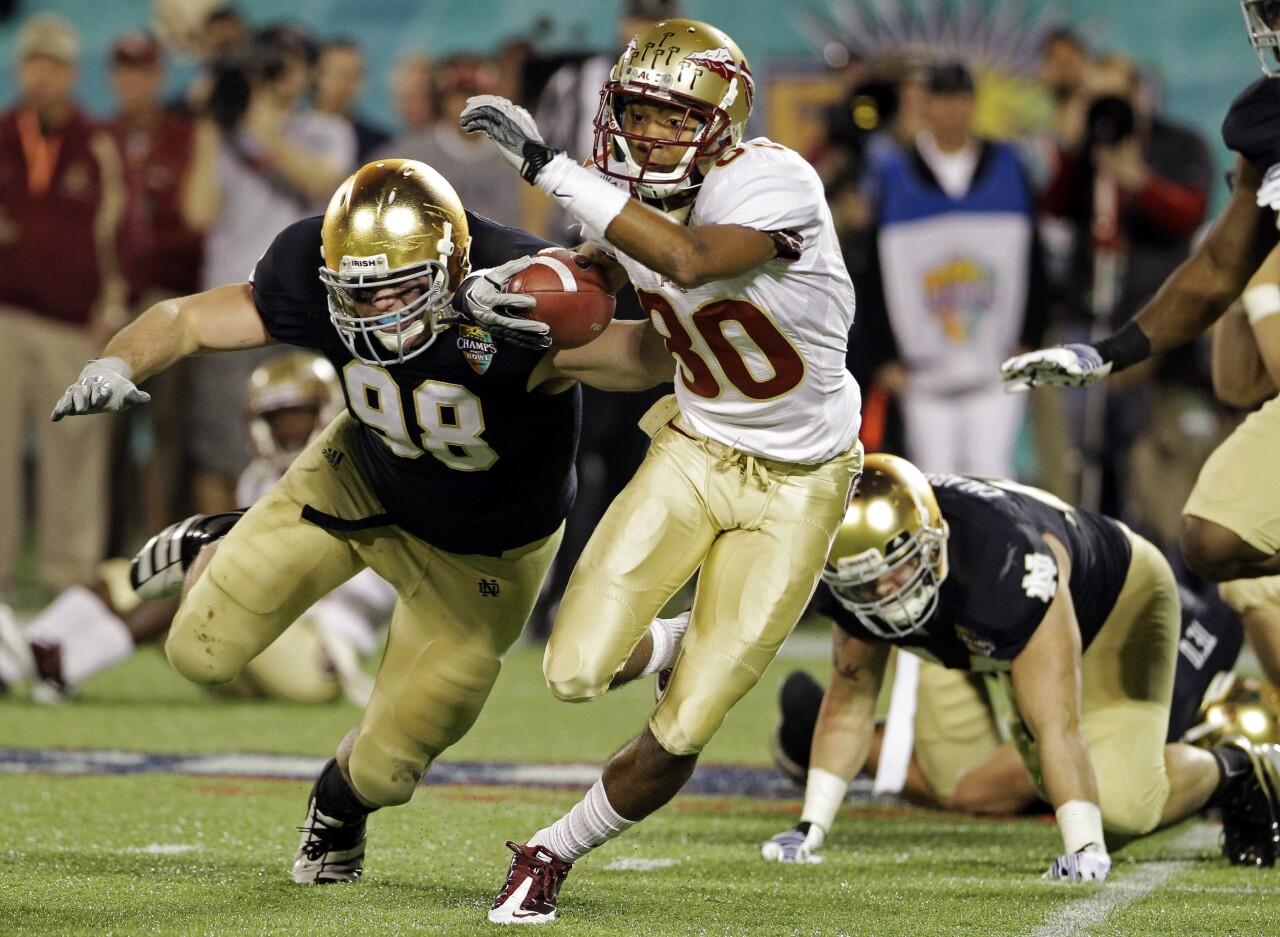 Florida State Seminoles receiver Rashad Greene runs from Notre Dame Fighting Irish in 2011 Champs Sports Bowl