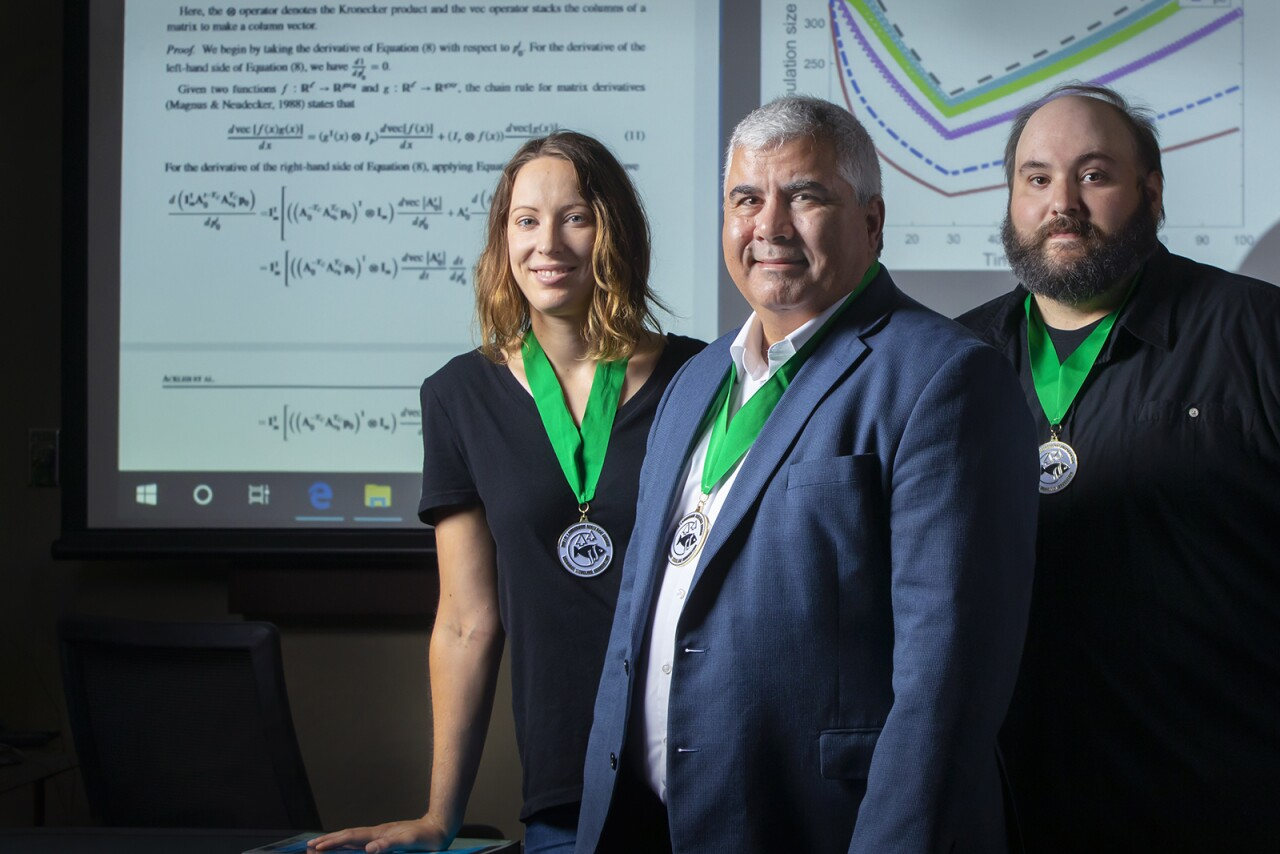 From left, Dr. Amy Veprauskas, Dr. Azmy S. Ackleh and Dr. Ross Chiquet, recipients of the Rollie Lamberson Research Award. (Photo credit: Doug Dugas / University of Louisiana at Lafayette)