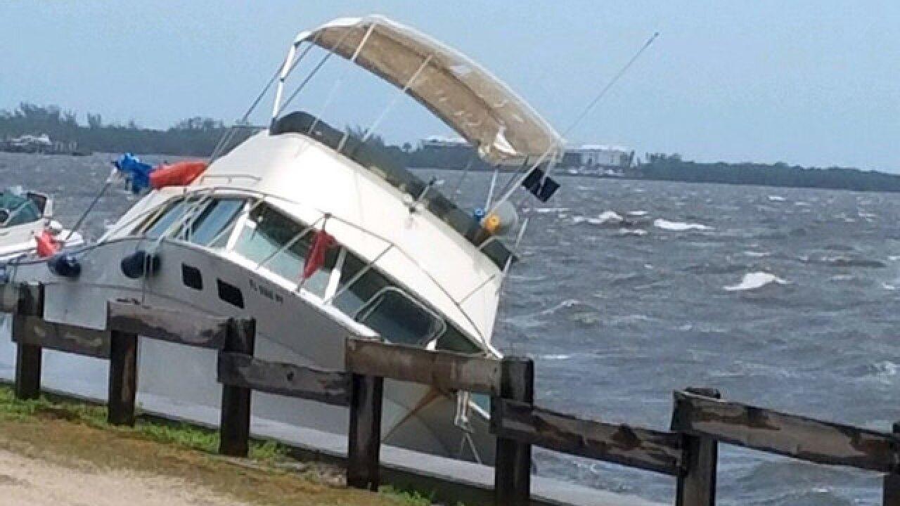 Rough seas, heavy winds send 2 boats into the rocks in Jensen Beach