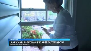 Woman escapes intruders through window