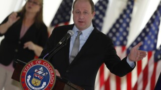 Gov. Polis issues executive orders slashing immediate budget, barring evictions, extending ski closures