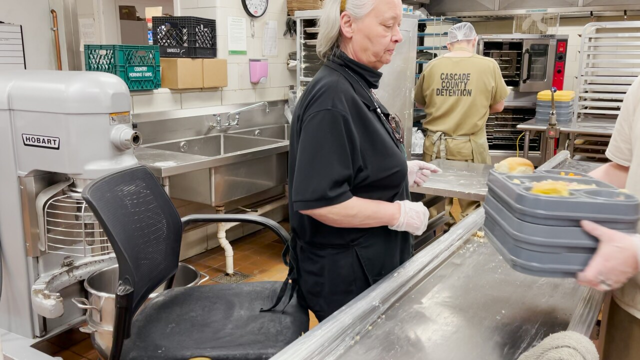 Kitchen staff at the Cascade County Detention Center prepares hundreds of meals per day