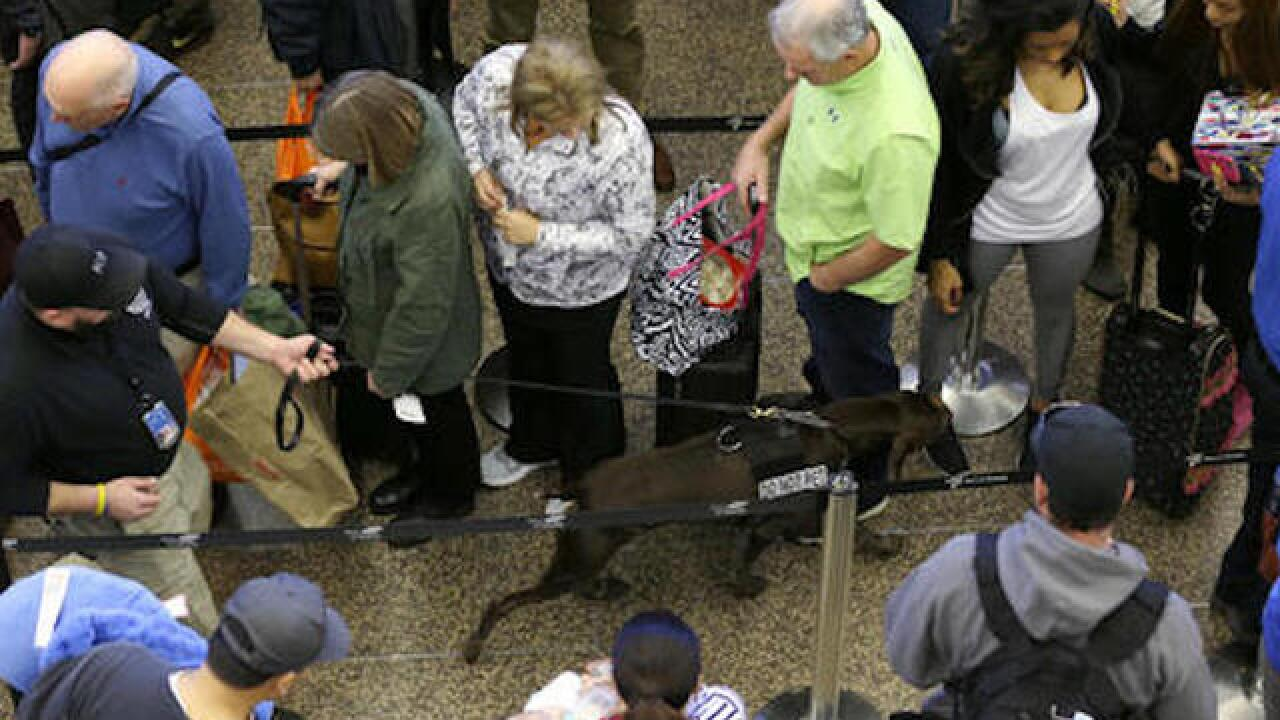 TSA sends dozens to Chicago to cut wait times