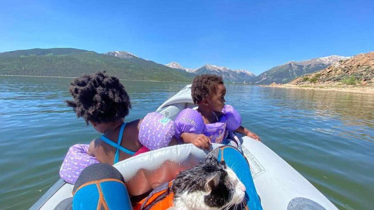 that cat pluto kayak with girls.jpeg