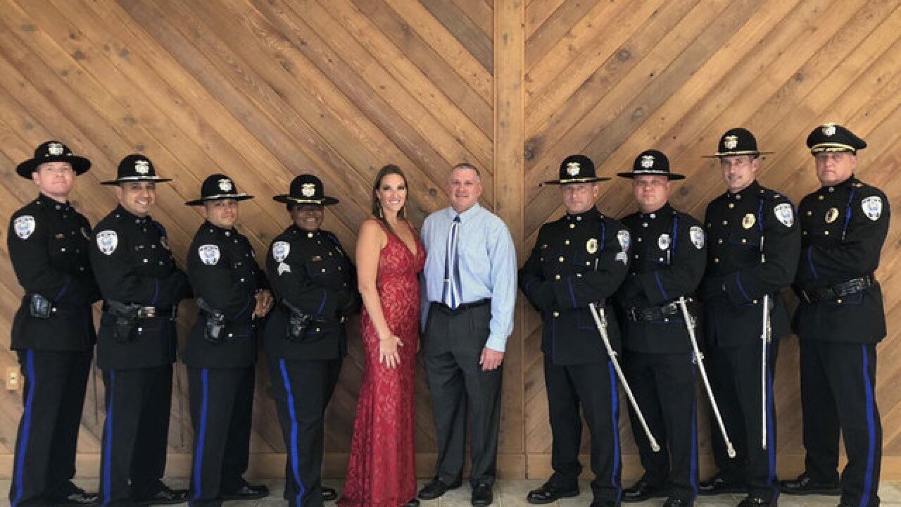Pact honored for fallen Fla. officer's daughter