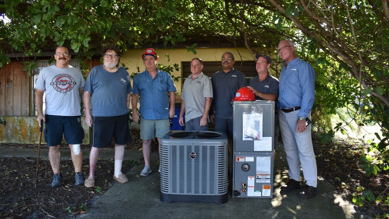 Photo 5 - Community partners donate AC unit to Jon Smith.JPG