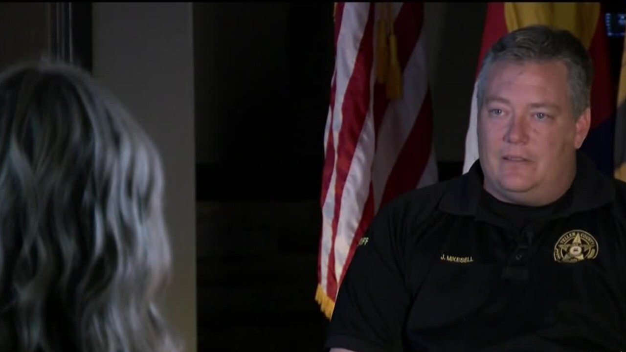 Dianne Derby talks with Teller County Sheriff Jason Mikesell