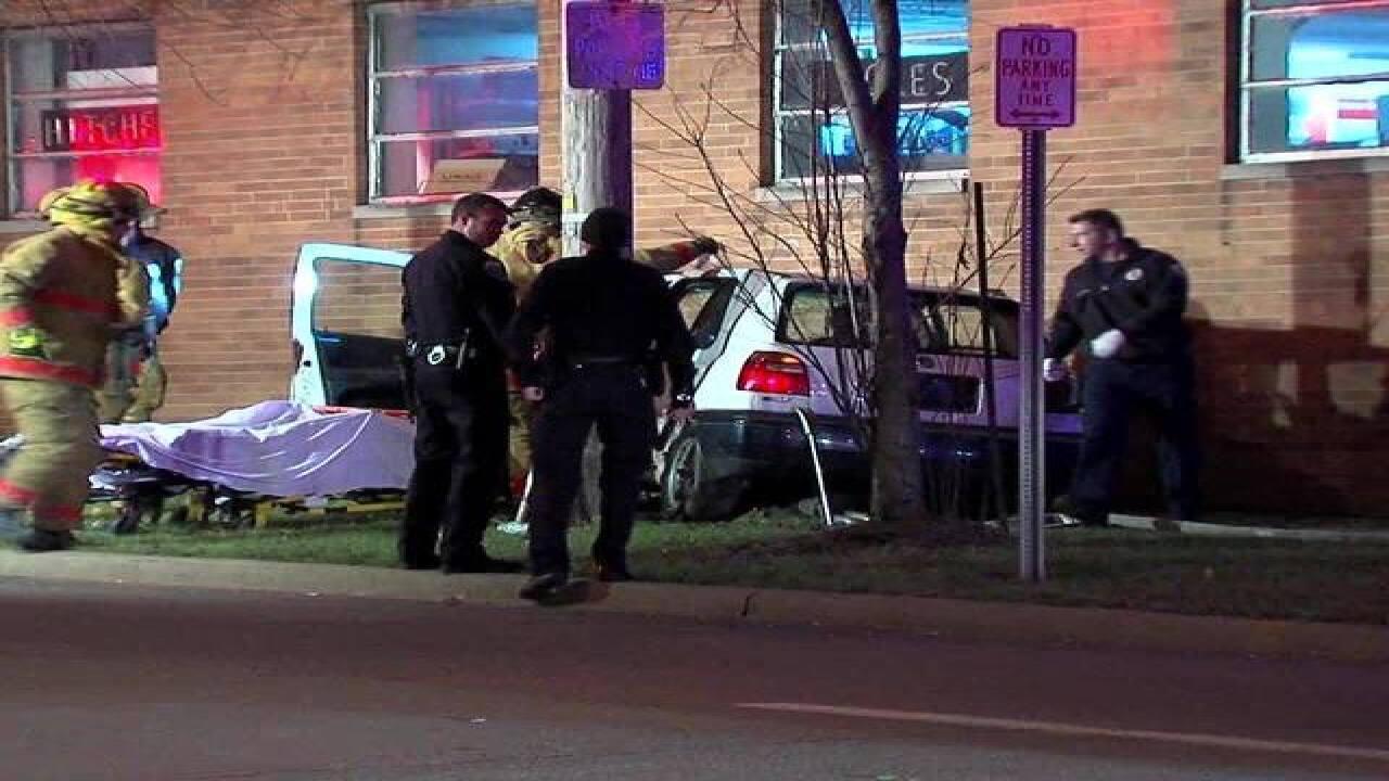 Driver leaves passenger after hitting building