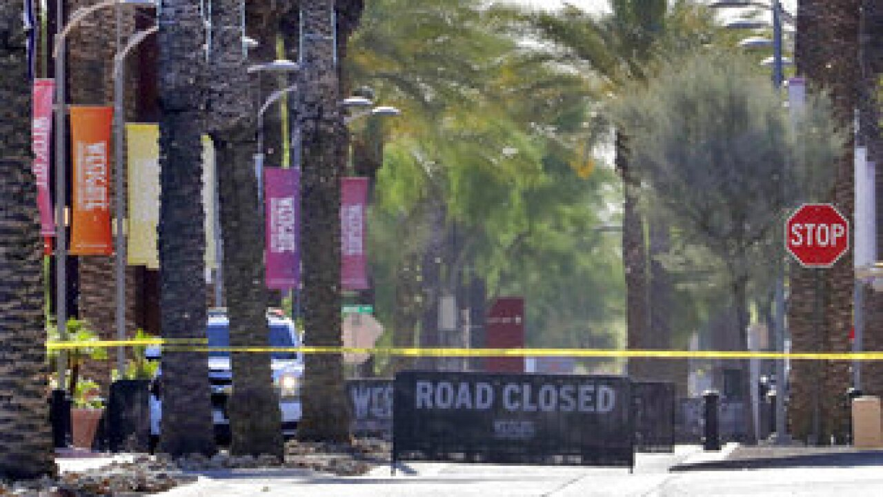Police say a man opened fire at a suburban Phoenix restaurant and retail complex because he wanted to retaliate for bullying.  Photo via AP.